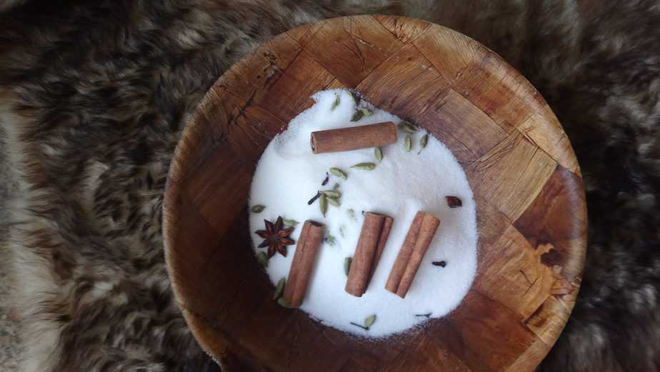 white cigarette butts on round brown wooden ashtray